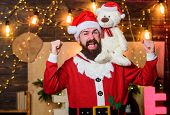 Charity For Kids. Man Bearded Santa Claus Play Soft Toy Teddy Bear. Christmas Charity. Charity Help. poster