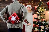 Giving And Sharing. Winter Surprise. Man Carry Gift Box Behind Back Defocused Background. Christmas  poster