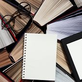 Many Multicolored Thick Open Books Stand On A Dark Background. On The Books Are Old Round Glasses An poster