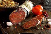 Croatian Spicy Sausage On Wooden Board. Kulen. poster