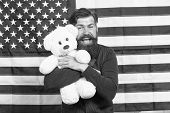 Holiday Toy Gift. Bearded Man Smiling With Independence Day Toy Gift. Happy Hipster Holding Teddy Be poster