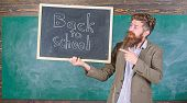 Hiring Teachers For New School Year. Man Bearded Holds Blackboard Inscription Back To School. Back T poster