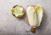 Peking Fresh Chinese Cabbages In Wood Bowl On A White Background. Top View. Cut Cabbage On Wooden Ch poster