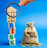 Wooden Blocks With The Word Risk And A Miniature House With A Money Bag. Real Estate Investment Risk poster