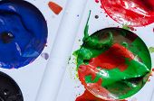 A Stain Of Red Paint In A Can Of Green Paint. A Palette Of Paints. Modern Art. Paint Splash. Colorfu poster