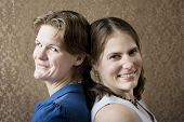 foto of soulmate  - Portrait of Two Young Women Friends Back to Back - JPG