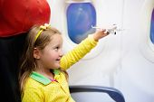 Child Flying In Airplane. Flight With Kids. poster