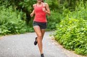 Running woman jogging in park. Healthy active lifestyle. poster