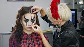 Easy Halloween Makeup. Girl In A Beauty Salon. Applying A Stylistic Pattern On The Face Of The Model poster