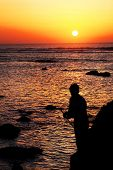 image of asilah  - Young boy fishing at Asilah Fortress - JPG
