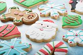 Christmas Sugar Cookies Decorated With Royal Icing With A Santa Cookie In The Middle poster