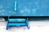 Paint Roller And Brush In Blue Paint Near The Painted Wall Of The Building. The Concept Of Professio poster
