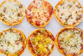 Set With Different Delicious Pizzas On White Background, Top View. Delicious Fresh Italian Pizza poster