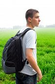 image of knapsack  - teenager with knapsack in the summer field - JPG