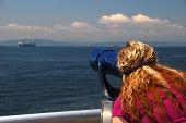 Woman Tourist Looking Through Telescope poster