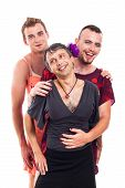 stock photo of transvestite  - Portrait of three laughing transvestites cross - JPG