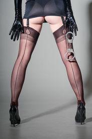 stock photo of girdles  - Closeup of dominatrix in girdle  - JPG