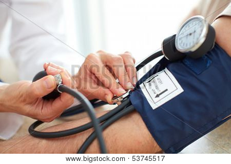 Blood pressure measuring. Doctor and patient.  Health care. poster