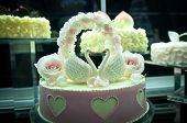 picture of tuck-shop  - small wedding cake with roses and swans figures - JPG