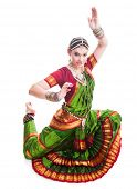 image of bharatanatyam  - Bollywood dancer in green and orange folded dress posing as cobra - JPG