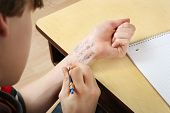 picture of cheater  - Student cheating writing answers on arm - JPG