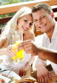 Good Morning - Couple Having Juice Smiling poster