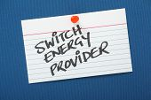 pic of tariff  - A reminder to Switch Energy Provider written on a note card pinned to a blue notice board - JPG