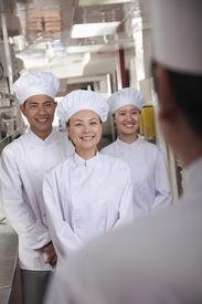 foto of pep talk  - Head chef speaking to assistants - JPG