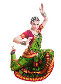 picture of bharatanatyam  - Bollywood dancer in green and orange folded dress posing as cobra - JPG