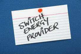 foto of tariff  - A reminder to Switch Energy Provider written on a note card pinned to a blue notice board - JPG