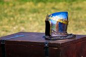 stock photo of duke  - Shiny helmet of the Grand Duke with the golden crown on a wooden chest - JPG