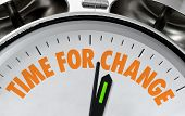 pic of change management  - Time for Change business proverb or message on a traditional silver chrome clock face - JPG