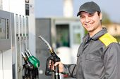 image of crude  - Gas station attendant at work - JPG