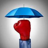 picture of safeguard  - Competition protection business concept with a red boxing glove from a businessman with a blue umbrella symbol protecting as a defense and buffer safeguard for risk and financial uncertainty - JPG