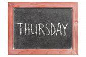 foto of thursday  - Thursday word handwritten on isolated vintage blackboard - JPG