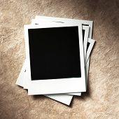 stock photo of polaroid  - polaroid style photo frames on cardboard - JPG