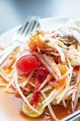stock photo of green papaya salad  - Green papaya salad thai food with frok and spoon - JPG