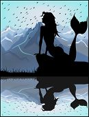 stock photo of fairy tail  - Mermaid silhouette on a background of blue mountains - JPG