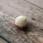 image of bonbon  - Coconut bonbon lying on a wooden table - JPG