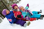 stock photo of cold-weather  - Winter fun snow happy children sledding at winter time - JPG
