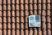 pic of red roof tile  - old broken dormer window in the red - JPG