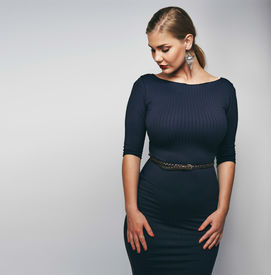 pic of curvy  - Studio image of elegant young lady in black dress - JPG