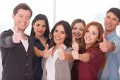 image of gesture  - Group of cheerful young people standing close to each other and gesturing - JPG
