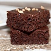 image of brownie  - dark soft brownies on white plate close up - JPG