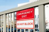 foto of gate  - Emergency Exit And Do Not Block Signboard On Gate - JPG