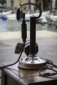 pic of xx  - An old telephone of the first years of the XX century exposed outside the bay of Lake of Garda Italy - JPG
