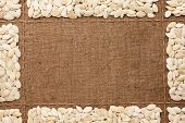 picture of sackcloth  - Beautiful frame with pumpkin seeds on sackcloth with place for your text graphics - JPG