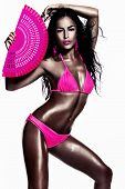 picture of studio  - beautiful tanned brunette in pink bikini holding fan studio white - JPG