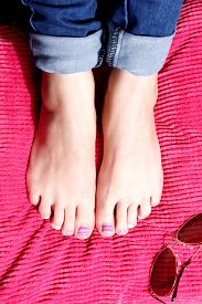 stock photo of painted toes  - Beautiful trendy colorful gel polished summer toes - JPG
