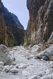 stock photo of samaria  - Rocky slopes Samaria Gorge on Crete Island - JPG